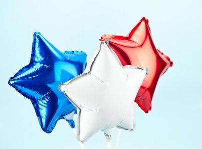Photo of three star shaped mylar balloons.