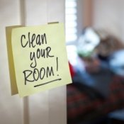 Post it note that says clean your room on it.