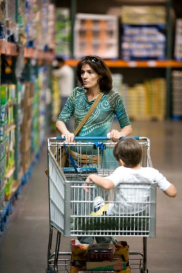 A woman shopping at a warehouse store.