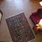 Downward photo of an area rug in a lobby