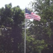 Flag pole in yard