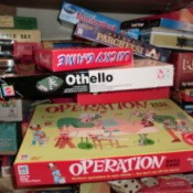 Messy pile of board game boxes.
