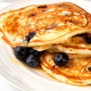 Blueberry pancakes on a plate.