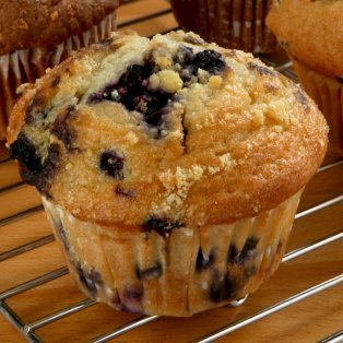 Blueberry muffin on a cooling rack.