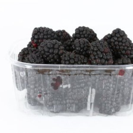 Clear container with blackberries inside.