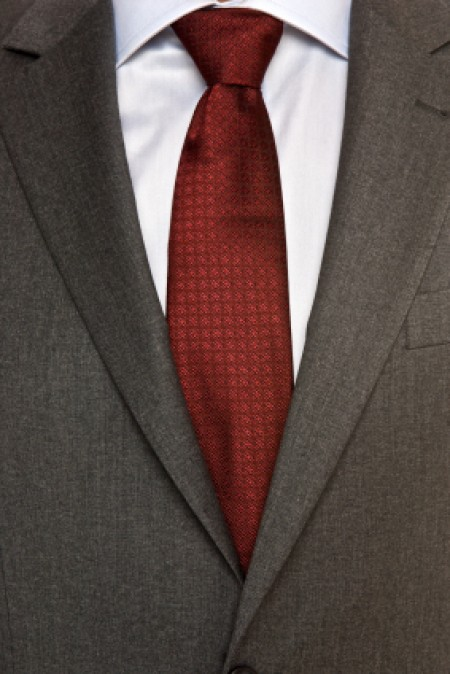 A business suit with a white shirt and red tie.