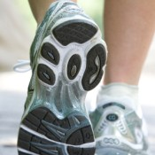 A picture of the feet of a woman in running shoes.