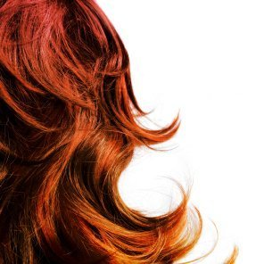 Red hair with curled ends.