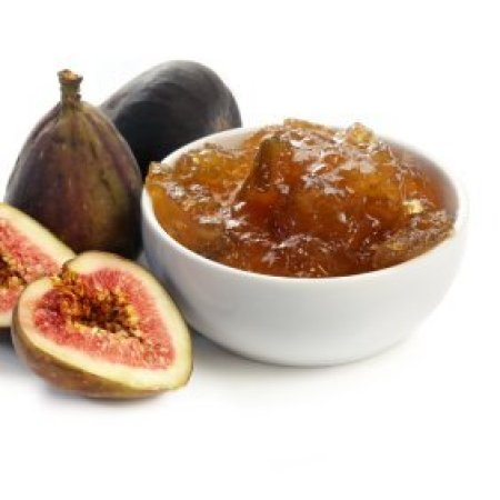 A bowl of fig jam and some fresh figs.