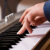 Closeup of a woman playing keyboard