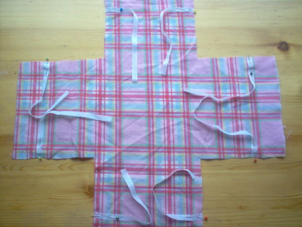 Ribbons pinned to plaid fabric
