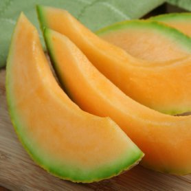 Cantaloupe slices on a table.