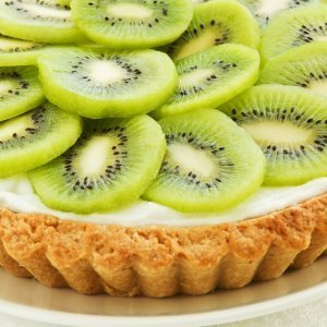 Kiwi tart on a white plate.