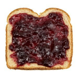 A slice of toast with grape jelly on it.