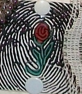 A close up of a fingerprint with a rose in the middle.