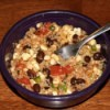 A quinoa salad with black beans, corn, tomatoes and other spices.