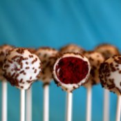 Valentine's Cake Pops, A row of cake pops with Red Velvet centers.