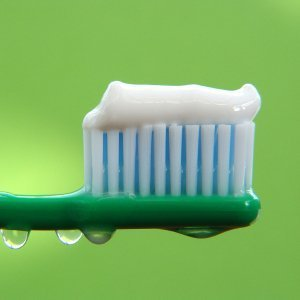 Closeup of wet toothbrush with paste.