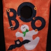 Orange treat bag with a ghost and bat motif.