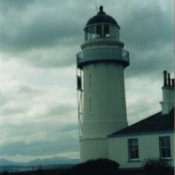Lighthouse on Isle of Bute in Scotland With Grey Cloud in Background