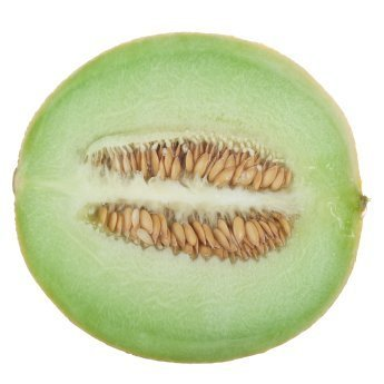 Honeydew melon sliced in half, stem to blossom end.