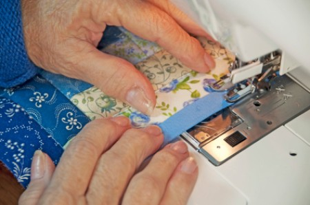 Making a quilt square on a home sewing machine.