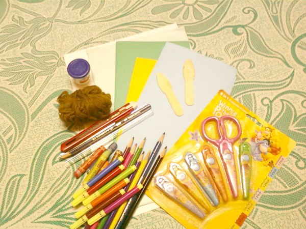 Sister card making supplies laid out on a table.