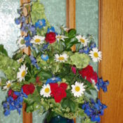 Bouquet of Red, White and Blue Flowers in a Blue Vase