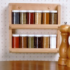 Mounting a Spice Rack on Your Wall, Spice rack hanging on a wall.