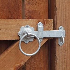 Metal latch on a wooden gate.