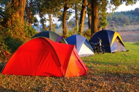 A row of camping tents.