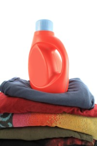 Generic Laundry Detergent on Top of Folded Clothes