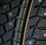 Saving Money on Studded Tires, A close up of the studs on the tread of a snow tire.