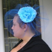 Woman wearing a handmade Fascinator