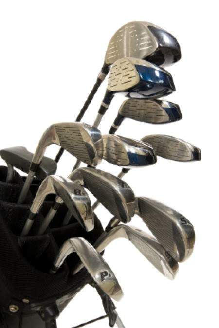 Saving Money on Golf Clubs, Set of Golf Clubs on White Background