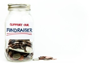 "Money jar with label that says ""Support Our Fundraiser"" on white background"