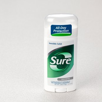 Photo of a stick of Sure deodorant.