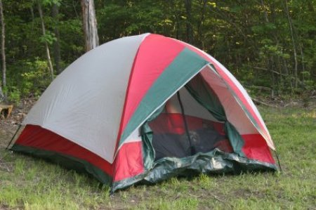 Photo of a tent set up in the woods.