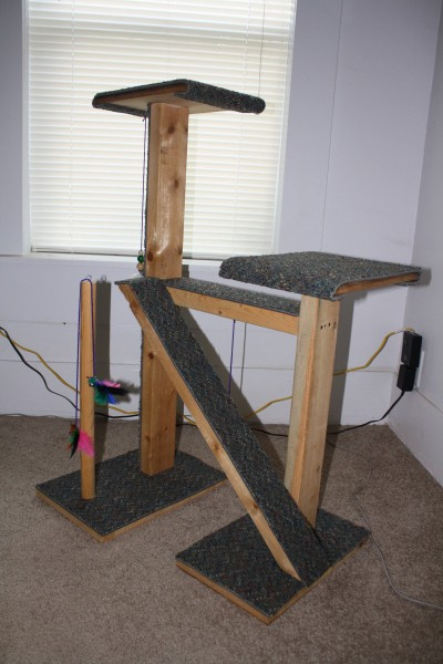 A homemade cat tree made with cheap and free materials.