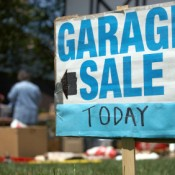 Garage Sale Sign in Front of House Having a Sale
