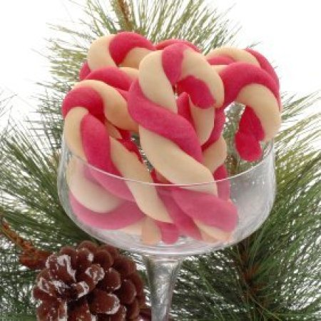 Glass stemmed dish filled with red and white candy cane cookies.