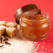 A sugar scrub with sugar near it.