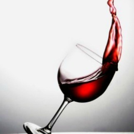 Removing Red Wine Stains from Marble, Removing Red Wine Stains from Clothing, Glass of red wine tipping over with wine splashing out.