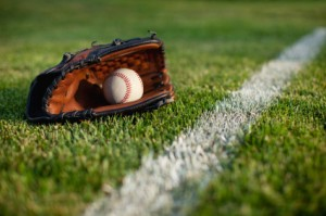 Baseball Glove with Ball in Glove on Grass
