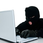 Preventing Identity Theft, Thief in mask on Computer