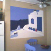 A white and blue mural painted on a kitchen wall.