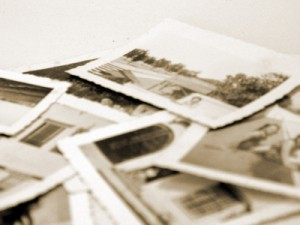 A stack of old black and white family photos.