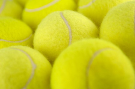 A pile of yellow tennis balls.