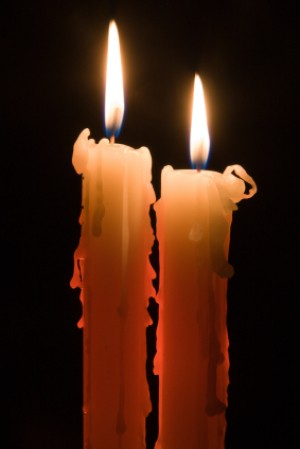 Two Lit Candles in the Dark