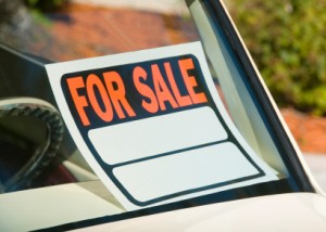 Buying a Cheap Car for First Time Driver, For Sale sign in Window of Used Car